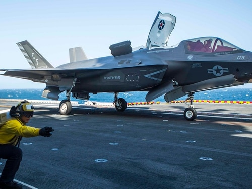 U.S. Navy Petty Officer 3rd Class Alexander Turla, an airman with the Essex Amphibious Ready Group, launches an F-35B Lightning II from Marine Fighter Attack Squadron 211, 13th Marine Expeditionary Unit, aboard the Wasp-class amphibious assault ship Essex (LHD 2), Sept. 3, 2018. (Cpl. A. J. Van Fredenberg/Marine Corps)