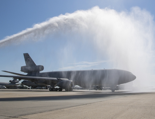 A KC-10 Extender receives a traditional water salute during a retirement at Joint Base McGuire-Dix-Lakehurst July 13. In recent DARPA tests, the plane showed the best results in testing, or least transmission or spread, for COVID-19-like particles inside an aircraft. (Air Force)