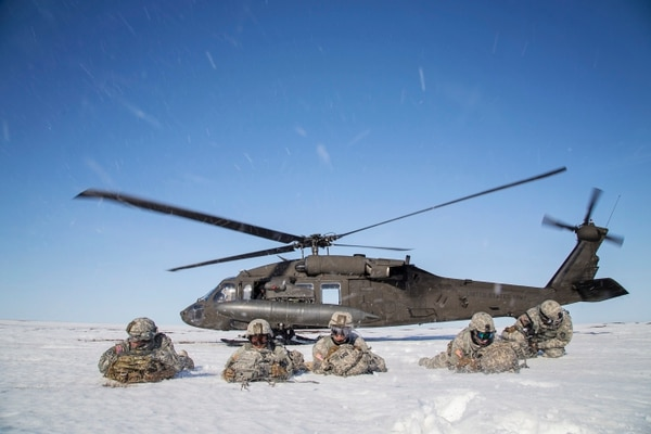 Paratroopers pull security after exiting a UH-60 Black Hawk helicopter during exercise Arctic Pegasus near Deadhorse, Alaska, May 1, 2014. (Sgt. Edward Eagerton/U.S. Army National Guard)