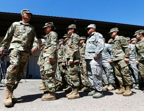 Arizona National Guard soldiers line up as they get ready for a visit from Arizona Gov. Doug Ducey prior their deployment to the Mexico border at the Papago Park Military Reservation Monday, April 9, 2018, in Phoenix. (Ross D. Franklin/AP)