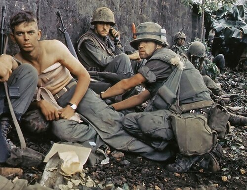 Navy Hospital Corpsman D.R. Howe treats the wounds of Pfc. D.A. Crum, with H Company, 2nd Battalion, 5th Marines, during Operation Hue City on Feb. 6, 1968. (National Archives/Office of the Secretary of Defense)