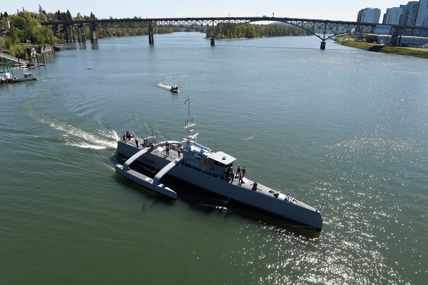 The unmanned submarine-hunting surface drone Sea Hunter gets underway on the Williammette River in Portland, Ore. Sea Hunter, developed by the Defense Advanced Research Projects Agency, represents an enormous technological leap for unmanned maritime systems. (John Williams/U.S. Navy)