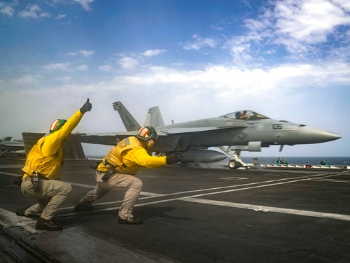 An F/A-18E Super Hornet launches from the flight deck of the Nimitz-class aircraft carrier USS Abraham Lincoln (CVN 72), which was sailing the Arabian Sea. (Mass Communications 3rd Class Jeff Sherman/Navy via AP)