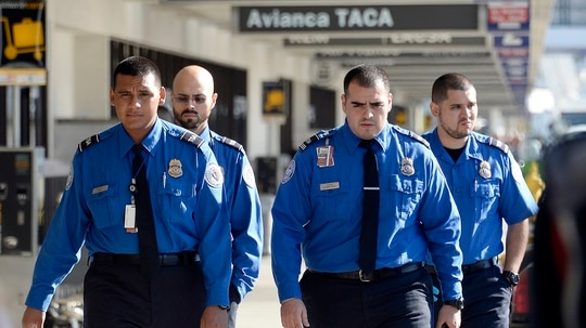 Transportation security officers do not currently have the same pay and workplace protections as most other federal employees. (Kevork Djansezian/Getty Images)