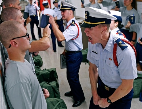 The Class of 2023 endures the first day of a seven-week indoctrination to military academy life on July 1 at the U.S. Coast Guard Academy in New London, Conn. On Wednesday, Congress released the results of an 18-month investigation into how the Coast Guard handles complaints of harassment and bullying. (Sean D. Elliot/The Day via AP)
