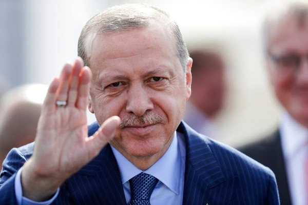 Turkey's President Recep Tayyip Erdogan waves to media after arrives at the airport Tegel for an official state visit in Germany at the capital Berlin, Thursday, Sept. 27, 2018. (Markus Schreiber/AP)