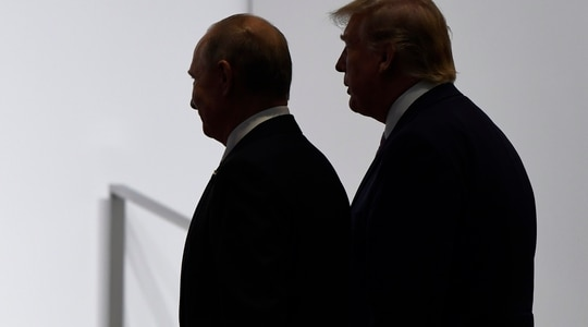 In this June 28, 2019, file photo, President Donald Trump and Russian President Vladimir Putin walk to participate in a group photo at the G20 summit in Osaka, Japan. (Susan Walsh/AP)