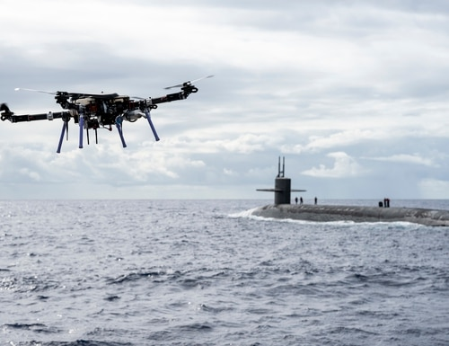 An unmanned aerial vehicle delivers a payload to the Ohio-class ballistic-missile submarine Henry M. Jackson around the Hawaiian Islands on Monday. (MC1 Devin M. Langer/Navy)