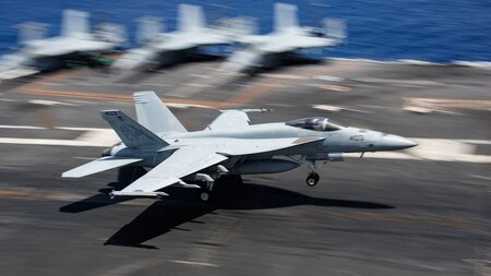 An F/A-18E Super Hornet makes an arrested landing on the flight deck of the carrier Abraham Lincoln. (U.S. Navy photo by MC3 Jeff Sherman)