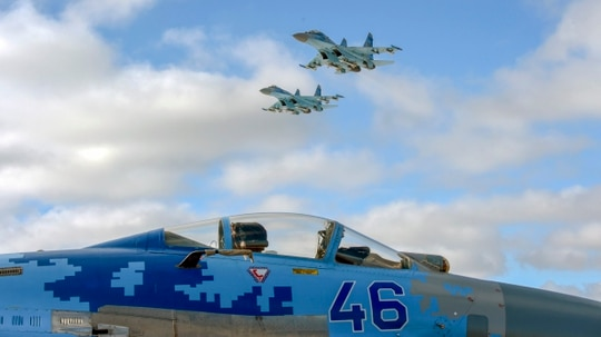 Ukrainian SU-27 planes fly over Ozerne air base, in Zhytomyr region in northern Ukraine, during a ceremony prior to the dispatch of Ukrainian troops to the east of the country, on December 6, 2018. (SERGEI SUPINSKY/AFP/Getty Images)