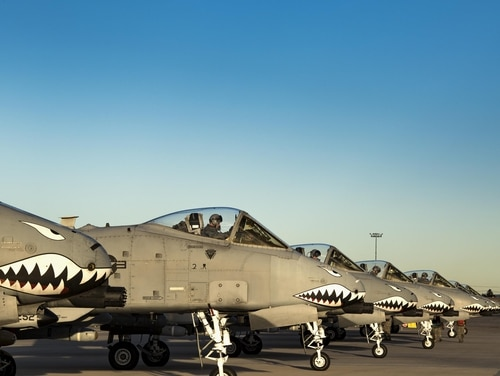 Seven A-10C Thunderbolt II aircraft from the 74th Fighter Squadron line up at the end of the runway for final preparations before take off during Green Flag-West 17-03, Jan. 24, 2017, at Nellis Air Force Base, Nev. The Air Force is poised to raise monthly flight pay for its officer and enlisted aircrew members beginning Oct. 1, 2017. (Staff Sgt. Ryan Callaghan/Air Force)