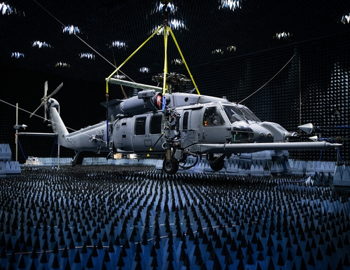 An HH-60W Pave Hawk with the 413th Flight Test Squadron hangs in the anechoic chamber at the Joint Preflight Integration of Munitions and Electronic Systems hangar in January 2020 at Eglin Air Force Base, Fla. The J-PRIMES anechoic chamber is a room designed to stop internal reflections of electromagnetic waves, as well as insulate from external sources of electromagnetic noise. (Samuel King Jr./Air Force)