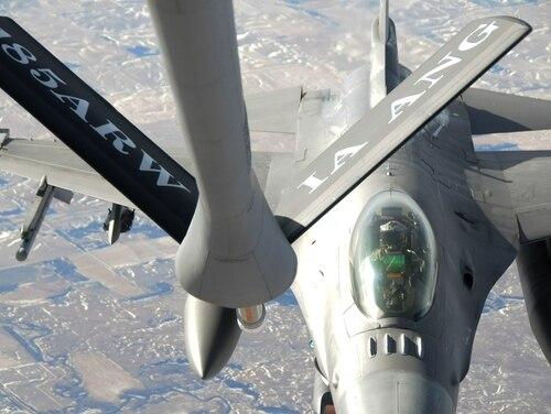 A KC-135 Strato Tanker refuels an F-16 Fighting Falcon Dec. 7, 2019, over South Dakota. (Capt. Ramah Husidic/Air Force)