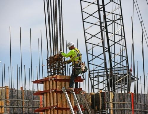 A worker installs a concrete form during construction of a new Veterans Affairs hospital in the Denver suburb of Aurora, Colo., on April 22, 2014. (RJ Sangosti/Denver Post via AP)
