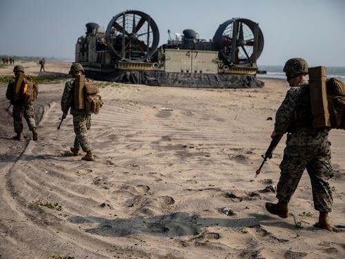 U.S. Marines with Combat Logistics Detachment 342 disembark a U.S. Navy landing craft air cushion during exercise Tiger TRIUMPH in Kakinada, India, Nov. 19, 2019. (Lance Cpl. Armando Elizalde/Marine Corps)