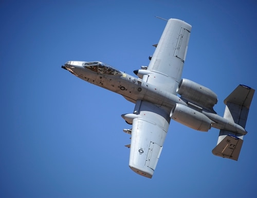 An A-10C Thunderbolt II assigned to the 23rd Fighter Group, Moody AFB, Ga., banks left after performing a low-angle strafe during the Hawgsmoke 2016 competition at the Barry M. Goldwater Range, Ariz., June 2, 2016. The competition took place over the course of two days and included team and individual scoring of strafing, high-altitude dive-bombing, Maverick missile precision and team tactics. (U.S. Air Force photo by Senior Airman Chris Drzazgowski/Released)