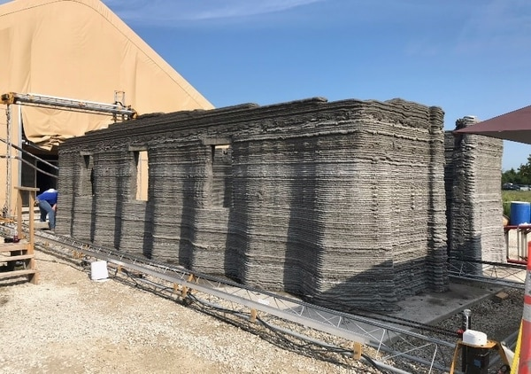 The world's largest concrete 3D printer constructs a 500-square-foot barracks hut at the U.S. Army Engineer Research and Development Center in mid-August in Champaign, Illinois. (Courtesy photo/Marine Corps)