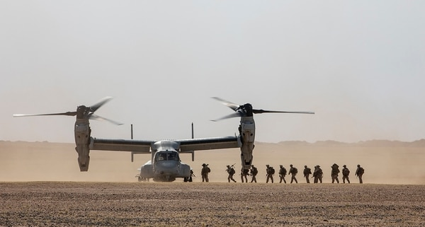 U.S. Marines and sailors with the 22nd Marine Expeditionary Unit board an MV-22 Osprey on April 12, 2019, after completing embassy reinforcement training during an exercise at Camp Beuhring, Kuwait. (Sgt. Aaron Henson/Marine Corps)