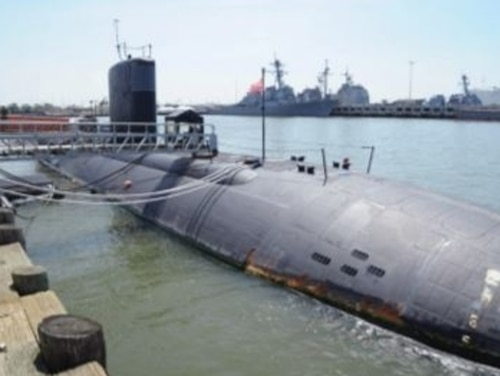 Originally scheduled to enter Norfolk Naval Shipyard for depot-level maintenance in 2013, workload delays continued for the attack submarine Boise through mid-2016. Because the boat's certificate for normal operations expired, it languished pierside at Norfolk Naval Station. (Navy)
