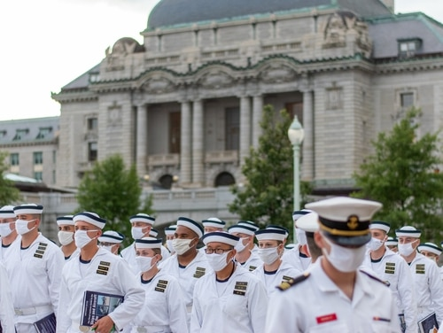 Second set detailers take over the training of Midshipmen 4th Class, or plebes, on Aug. 1, 2020, at the United States Naval Academy, marking the halfway point of Plebe Summer, a demanding indoctrination period intended to transition the candidates from civilian to military life. (Navy)