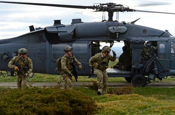 Pararescuemen with the 57th Rescue Squadron depart an HH-60G Pave Hawk during training in Scotland. (Senior Airman Erin O'Shea/Air Force)