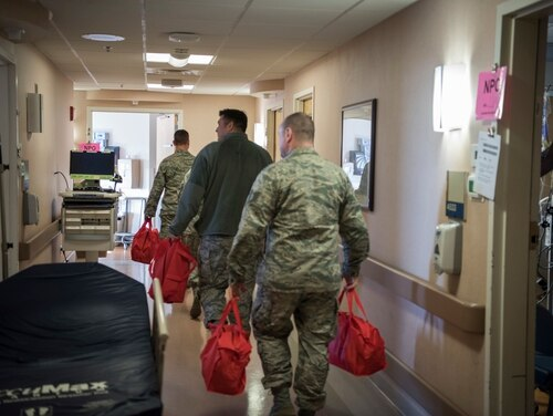 Air National Guard members visit the Milwaukee Veterans Affairs Hospital in Wisconsin to deliver care packages to patients on Dec. 12, 2019. (Master Sgt. Kellen Kroening/Air National Guard)