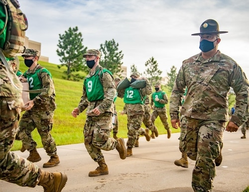 Infantry recruits haul supplies on the run in August 2020 as part of a mock battlefield resupply exercise. (Patrick A. Albright/Army)