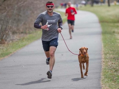 Air Force Capt. Brad Byington is positioning his finances to carry him through retirement and his golden years. He's shown here with his dog Rudy. (Courtesy photo)