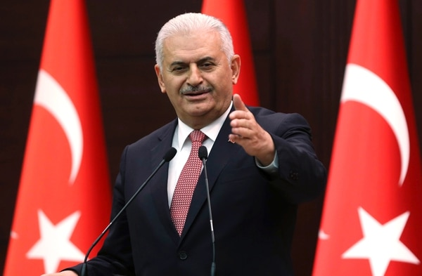 Turkish Prime Minister Binali Yildirim gestures as he delivers a speech during a press conference after a Turkish-Israeli meeting, at the Cankaya Palace in Ankara, on June 27, 2016. A breakthrough Israel-Turkey deal following six years of acrimony will see Israel pay $20 million (18,14 million euros) in compensation for a deadly 2010 commando raid, Turkish Prime Minister Binali Yildirim said on June 27. The deal will also see the two countries exchange ambassadors
