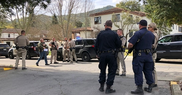 Law enforcement members stage at the Veterans Home of California after reports of an active shooter Friday, March 9, 2018, in Yountville, Calif. Napa County Fire captain Chase Beckman says a gunman has taken hostages at the veterans home in California. (JL Sousa/Napa Valley Register via AP)
