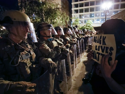 Utah National Guard soldiers line the street as demonstrators gather to protest the death of George Floyd, Wednesday, June 3, 2020, near the White House in Washington. Floyd died after being restrained by Minneapolis police officers. (Alex Brandon/AP)
