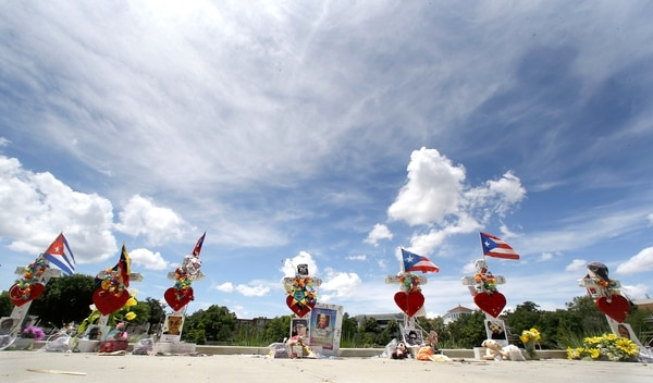 Seven of the 49 crosses representing the 49 victims of the Pulse nightclub shooting are seen Monday, July 11, 2016, near the Orlando Regional Medical Center in Orlando, Fla. (AP Photo/John Raoux)