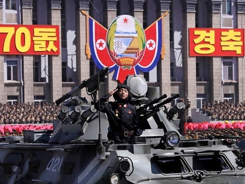 A commander salutes as he rolls past in an armored vehicle during a parade for the 70th anniversary of North Korea's founding day in Pyongyang, North Korea, Sunday, Sept. 9, 2018. North Korea staged a major military parade, huge rallies and will revive its iconic mass games on Sunday to mark its 70th anniversary as a nation. (Kin Cheung/AP)