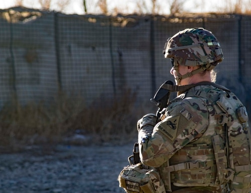 U.S. Army Sgt. 1st Class Kristen R. Bell, supporting the Headquarters and Headquarters Battalion, 1st Armored Division, observers her sector and provides security following a key leader engagement Dec. 29, 2019, in Southeastern Afghanistan. (Master Sgt. Alejandro Licea/Army)