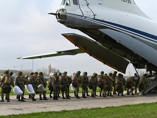 Russian paratroopers load into a plane for airborne drills during maneuvers in Taganrog, Russia, on April 22, 2021. (AP Photo)
