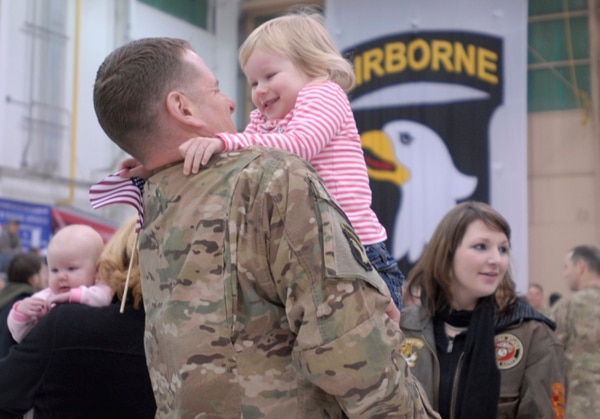 "A soldier from Angel Company, 3rd Battalion, 187th Infantry Regiment, 3rd Brigade Combat Team ""Rakkasans,"" 101st Airborne Division (Air Assault) embraces his daughter while being recognized at a welcome home ceremony March 1 at the Fort Campbell Army Airfield when he returned from a deployment to Afghanistan in support of Operation Enduring Freedom. The majority of Angel Company returned after about six months rather than the full nine months due to the progress of Afghan Security Forces in their area of responsibility, who are now conducting operations independently. (U.S. Army photo taken by Sgt. Alan Graziano, 3rd Brigade Combat Team, 101st Airborne Division)"