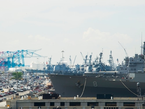 US Navy ships line the pier at Naval Station Norfolk in Norfolk,w here a bomb threat led to a lockdown at the piers Wednesday morning. (JIM WATSON/AFP/Getty Images)