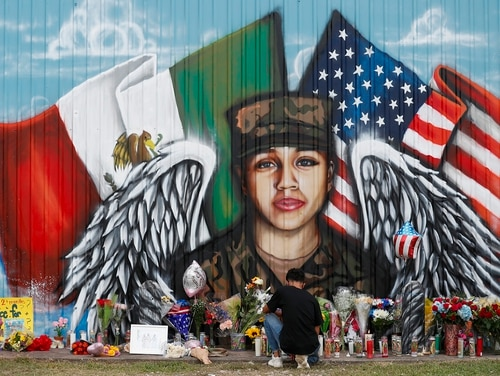 Juan Cruz, boyfriend of Army soldier Vanessa Guillén, kneels in front of a mural honoring her on July 5, 2020, in Houston. (Godofredo A. Vásquez/Houston Chronicle via AP)