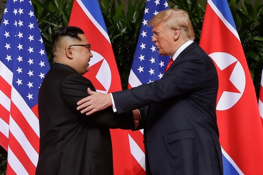 In this June 12, 2018, file photo, President Donald Trump, right, shakes hands with North Korea leader Kim Jong Un at the Capella resort on Sentosa Island in Singapore. (Evan Vucci/AP)