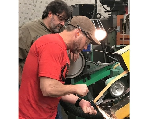Kevin Holland, who served as a special operator with both the Navy and Army, shapes a blade at a Case manufacturing facility. He and another Navy SEAL veteran are the first two service members to design knives for the American Heroes Series. (Courtesy of Case)