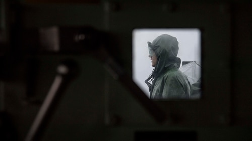 The Navy is implementing regulations aimed at getting ship crews more sleep while cutting back on the most grueling watch schedules. Here, a sailor stands watch on the amphibious transport dock ship San Diego in August. (MC3 Justin A. Schoenberger/Navy)