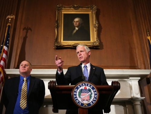 WASHINGTON, DC - JANUARY 06: U.S. Sen. Ron Johnson (R-WI) (R) speaks as attorney Rick Esenberg (L) listens during a news conference January 6, 2014 on Capitol Hill in Washington, DC. Sen. Johnson held the news conference to announce a lawsuit against the Office of Personnel Management challenging the Affordable Care Act regulation that allows congressional staff to keep their employer contributions for use toward the purchase of a health insurance plan. (Photo by Alex Wong/Getty Images)