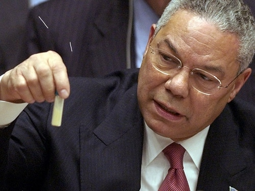 Then Secretary of State Colin Powell holds up a vial representing the threat of anthrax as he presents evidence of Iraq's alleged weapons of mass destruction to the United Nations Security Council Feb. 5, 2003. (Elise Amendola/AP)