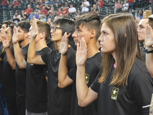 Future soldiers recite the oath of enlistment at Chase Field, Phoenix, prior to a Major League Baseball game. (Mike Scheck/Army)