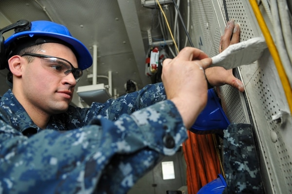 NEWPORT NEWS, Va. (Jan. 16, 2013) -- Aviation Ordnanceman Airman Julian Concepcion, assigned to the Nimitz-class aircraft carrier USS Abraham Lincoln's (CVN 72) lagging team, paints a section of a bulkhead in a compartment. Lincoln is currently undergoing a Refueling and Complex Overhaul (RCOH) at Newport News Shipbuilding, a division of Huntington Ingalls Industries. (U.S. Navy photo by Mass Communication Specialist 3rd Class Danian Douglas/RELEASED)