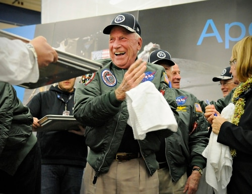 In this Nov. 12, 2014, file photo, Apollo 15 astronaut Al Worden wipes his hands after creating a cast of his hand prints that will be part of a permanent display at Apollo High School in St. Cloud, Minn. Worden, who circled the moon alone in 1971 while his two crewmates tried out the first lunar rover, has died at age 88, his family said Wednesday, March 18, 2020. (Jason Wachter/St. Cloud Times via AP)