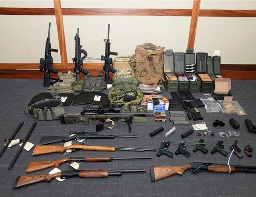 This undated file image provided by the U.S. District Court in Maryland shows a photo of firearms and ammunition that was in the motion for detention pending trial in the case against Christopher Hasson. (U.S. District Court via AP)