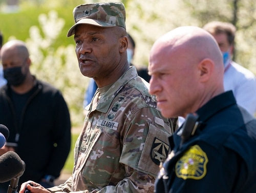 Brig. Gen. Michael J. Talley, left, commander of U.S. Army Medical Research and Development Command at Fort Detrick, Md., and Frederick Maryland Police Chief Jason Lando speak to reporters near the scene of a shooting at a business park in Frederick, Md., Tuesday. (Carolyn Kaster/AP)
