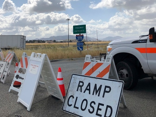 An on ramp to Interstate 215 is closed off Friday in California. A wide area, including the 215 freeway, remained off-limits around an F-16 fighter jet crash site in Southern California as military and civilian authorities investigated. (Amy Taxin/AP)