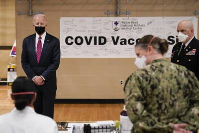 President Joe Biden tours the COVID-19 vaccine center at Walter Reed National Military Medical Center, Friday, Jan. 29, 2021, in Bethesda, Md.
